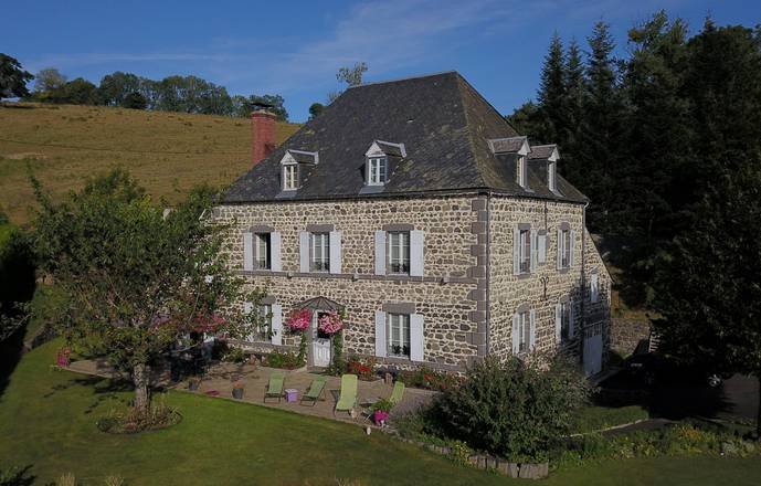 Mansion of XIX ème century surrounded by meadows in Parc Naturel Régional des Volcans d'Auvergne between Chaîne des Puys and Massif du Sancy.